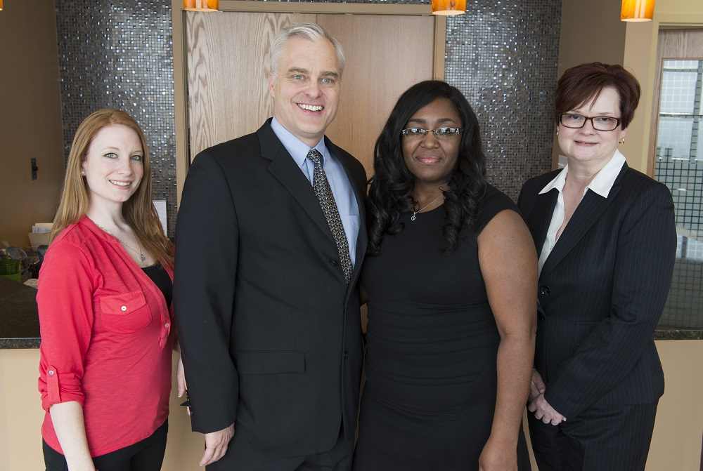 A picture of Dr. Wright with the St. Louis Laser Liposuction Center's office team.